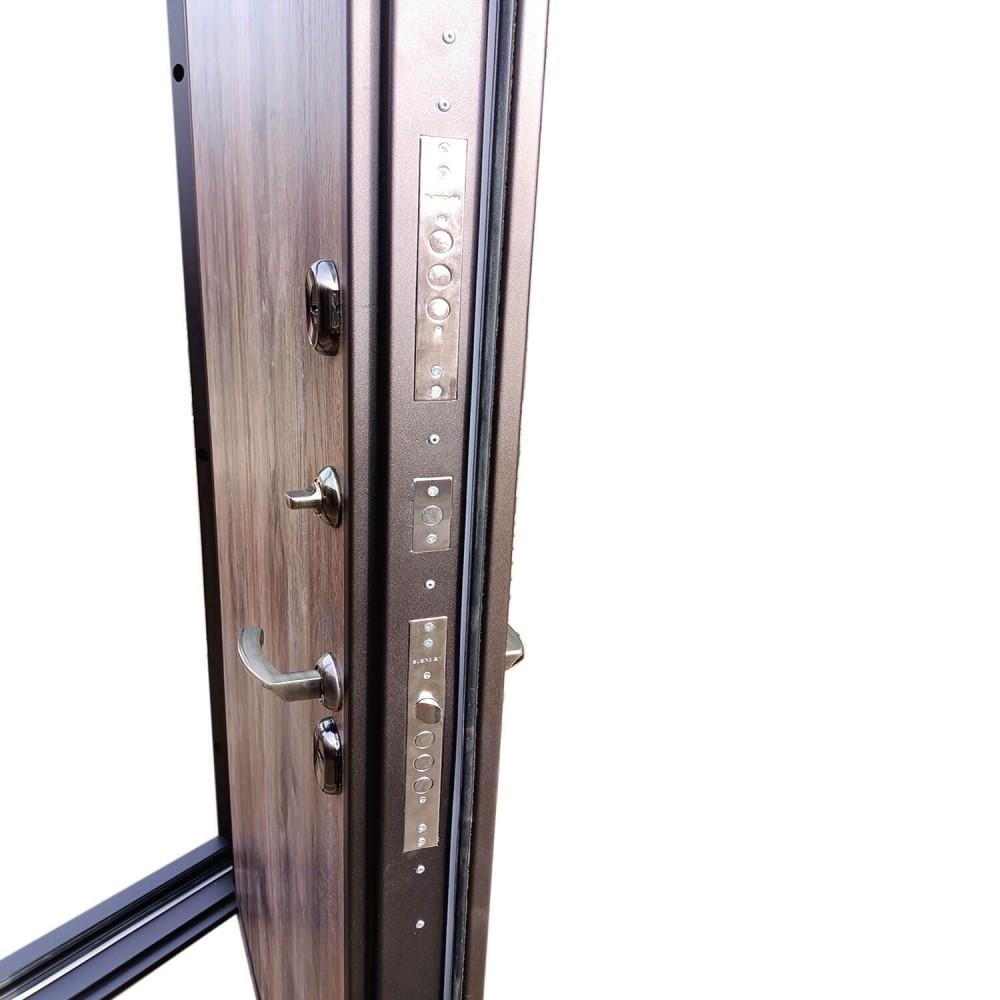 Дверь с терморазрывом М-15-110 медный текстурный / дуб бомод лофт